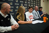 NWA Democrat-Gazette/CHARLIE KAIJO Cash Jones is shown with coach James Rappe, his mother Sheila Jones, father David Jones and coach Billy Tally on Thursday, November 9, 2017 at Bentonville High School in Bentonville. Cash Jones signed his national letter of intent with Campbell University, an NCAA Division I school in North Carolina.