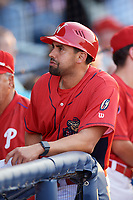 Williamsport Crosscutters hitting coach Christian Marrero (24) in the dugout before a game against the Mahoning Valley Scrappers on August 28, 2018 at BB&T Ballpark in Williamsport, Pennsylvania.  Williamsport defeated Mahoning Valley 8-0.  (Mike Janes/Four Seam Images)