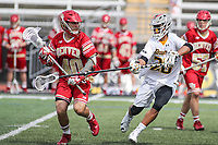 Towson, MD - March 25, 2017: Towson Tigers Sid Ewell (20) defends Denver Pioneers Connor Cannizzaro (40) during game between Towson and Denver at  Minnegan Field at Johnny Unitas Stadium  in Towson, MD. March 25, 2017.  (Photo by Elliott Brown/Media Images International)