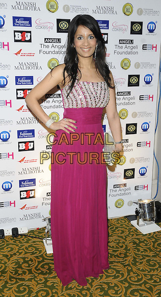 Sonali Shah.attended the Manish Malhotra Fashion Extravaganza, Grosvenor House Hotel, Park Lane, London, England..February 23rd, 2013.full length pink silver dress hand on hip clutch bag .CAP/CAN.©Can Nguyen/Capital Pictures.
