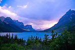 Montana, Glacier National Park. Evening light breaks through the clouds over St. Mary Lake on a stormy summer evening.