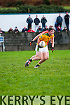 Castlegregory Alan Fitzgerald in possession of the ball closely watched by Daingean Uí Chúis Brian Ó Dubhain during the West Kerry Semi-Final at Annascaul GAA Grounds on Saturday afternoon.