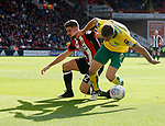Ched Evans of Sheffield Utd is blocked by Christoph Zimmermann of Norwich City during the Championship match at Bramall Lane Stadium, Sheffield. Picture date 16th September 2017. Picture credit should read: Simon Bellis/Sportimage
