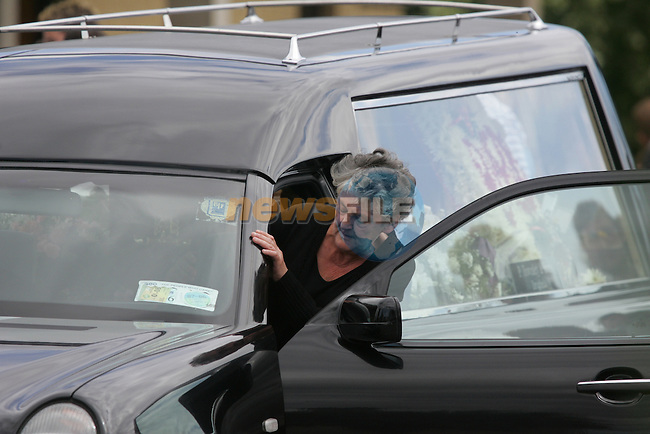 The funeral of Breda Ryan from the Holy Family Church in Drogheda. Her Mother sits in the front of the Funeral car,  Grey hair..Photo: Fran Caffrey/ Newsfile.