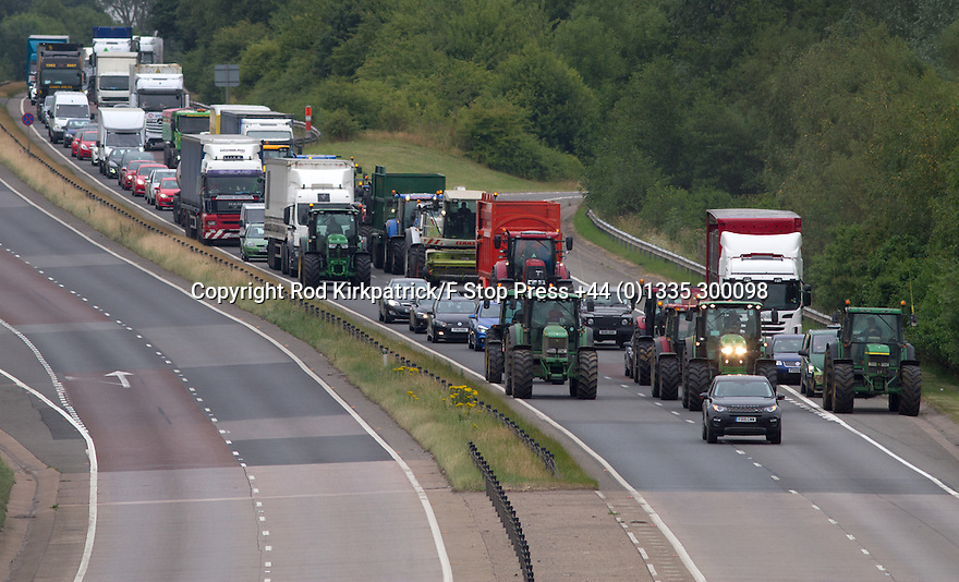 24/07/15<br /> <br /> Bringing traffic to a standstill for miles, a convoy of tractors, which reached almost forty in number at one point, blocks the A50 near Sudbury, Derbyshire. The farmers are protesting at today's  0.8pence per litre reduction in the amount milk processing giant, Arla, are paying dairy farmers, <br /> <br /> <br /> All Rights Reserved: F Stop Press Ltd. +44(0)1335 418629   www.fstoppress.com.
