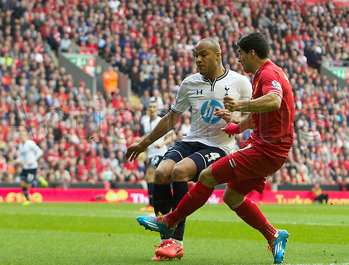 30.03.2014  Liverpool, England.   Liverpool's Luis Suarez beats Kaboul and then scores to make it 2-0 during the Premier League game between Liverpool and Tottenham Hotspur from Anfield