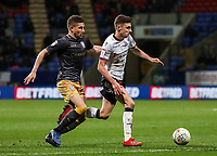 Bolton Wanderers' Joe Williams competing with Sheffield Wednesday's Morgan Fox <br /> <br /> Photographer Andrew Kearns/CameraSport<br /> <br /> The EFL Sky Bet Championship - Bolton Wanderers v Sheffield Wednesday - Tuesday 12th March 2019 - University of Bolton Stadium - Bolton<br /> <br /> World Copyright © 2019 CameraSport. All rights reserved. 43 Linden Ave. Countesthorpe. Leicester. England. LE8 5PG - Tel: +44 (0) 116 277 4147 - admin@camerasport.com - www.camerasport.com