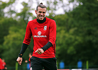 Gareth Bale smiles to team mates during the Wales Training Session at the Vale Resort, Hensol, Wales, UK. Tuesday 29 August 2017