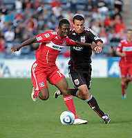 Chicago Fire forward Patrick Nyarko (14) battles for the ball with DC United defender Jed Zayner (12).  The Chicago Fire tied DC United 0-0 at Toyota Park in Bridgeview, IL on Oct. 16, 2010.