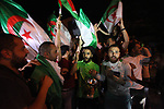 Palestinian supporters celebrate after Algeria won the 2019 Africa Cup of Nations (CAN) final football match against Senegal, at the Gaza seaport, in Gaza city on July 19, 2019. Photo by Mahmoud Ajjour