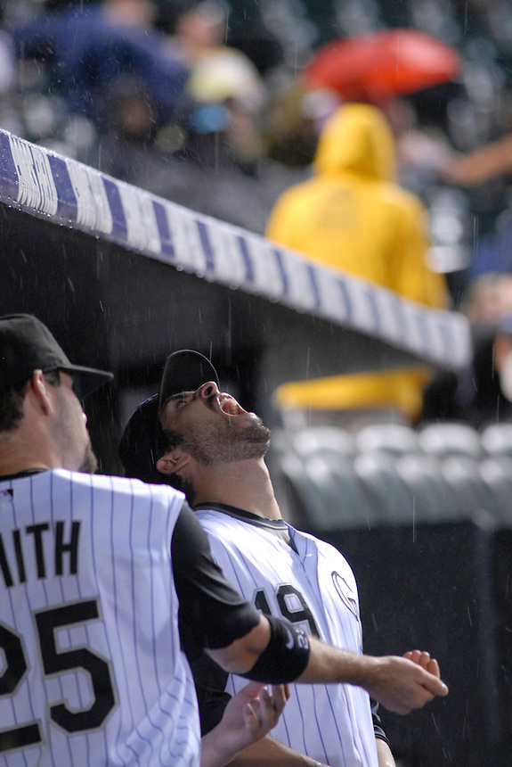 12 August 08: Rockies outfielder Ryan Spilborghs catches rain and hail in his mouth during a game between the Arizona Diamondbacks and the Colorado Rockies at Coors Field in Denver, Colorado. FOR EDITORIAL USE ONLY.