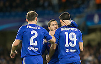 Eden Hazard (centre) of Chelsea congratulates Diego Costa of Chelsea as they take a 1-0 lead during the UEFA Champions League group G match between Chelsea and FC Porto at Stamford Bridge, London, England on 9 December 2015. Photo by Andy Rowland.