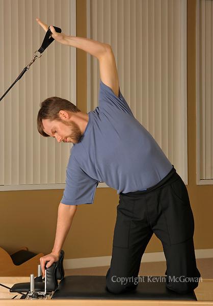 Pilates instructor Donal Kavanaugh on Reformer apparatus