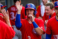 Buffalo Bisons catcher Reese McGuire (3) gets high fives in the dugout during an International League game against the Indianapolis Indians on July 28, 2018 at Victory Field in Indianapolis, Indiana. Indianapolis defeated Buffalo 6-4. (Brad Krause/Four Seam Images)