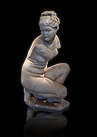 Crouching Aphrodite (Venus). 2nd Century  Roman Marble Statue from Marmol. Cordoba Archaeological Museum, Spain.