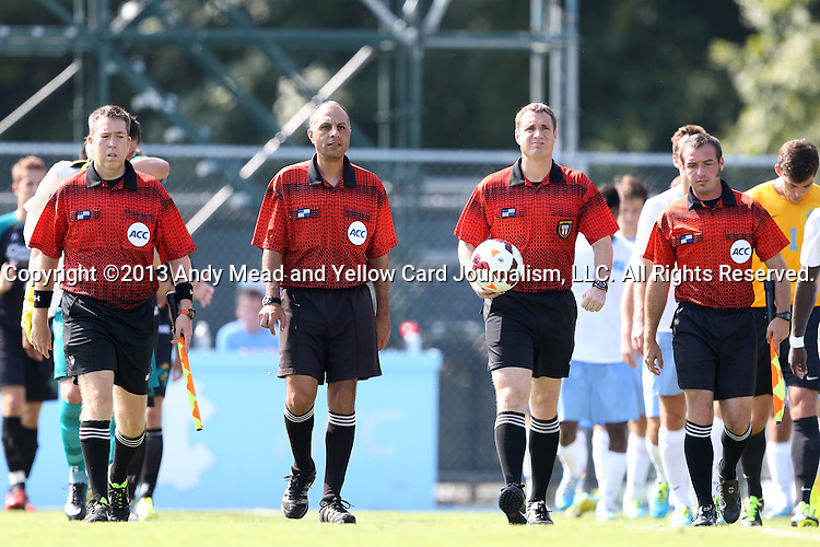 02 September 2013: Match officials: (from left): Assistant referee Aaron Gallagher, Fourth Official Ahmed Mohamed, Referee Mark Kadlecik, Assistant referee Justin Bradford. The University of North Carolina Tar Heels hosted the Coastal Carolina University Chanticleers at Fetzer Field in Chapel Hill, NC in a 2013 NCAA Division I Men's Soccer match. UNC won the game 4-0.