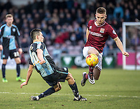Sam Hoskins of Northampton Town skips over Luke O'Nien of Wycombe Wanderers during the Sky Bet League 2 match between Northampton Town and Wycombe Wanderers at Sixfields Stadium, Northampton, England on the 20th February 2016. Photo by Liam McAvoy.