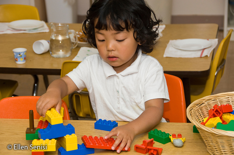 MR / Kensington, Maryland.Crossway Community Montessori School.Private, nonprofit early childhood education for children aged infant through age 6..Many of the students are children of parents from an associated program, Family Leadership School, for single-parent, low income families who live onsite..Primary Class.Student (girl, 3, Korean-American) plays with large connecting blocks (legos) at free time..MR: Lee6.© Ellen B. Senisi
