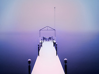 Pier on Lake Tahoe with snowstorm. California