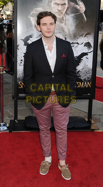 "Sam Claflin.The Los Angeles Screening of ""Snow White And The Huntsman"" at Westwood Village Theatre in Westwood, California, USA..May 29th, 2012 .full length black suit jacket white shirt purple pink jeans denim.CAP/ROT/TM.©Tony Michaels/Roth Stock/Capital Pictures"
