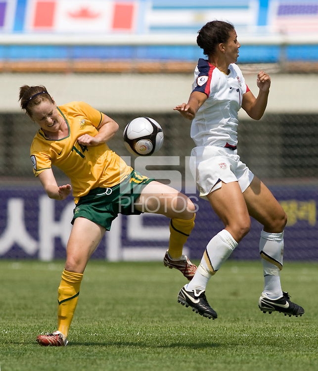 USWNT midfielder (7) Shannon Boxx collides with Australia's (14) Collette McCallum during the Peace Queen Cup  in Suwon, South Korea.  The U.S. defeated Australia, 2-1, at the Suwon Sports Complex.