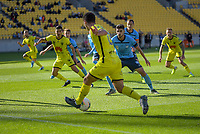 Liberato Cacace passes to Ulises Davila during the A-League football match between Wellington Phoenix and Sydney FC at Sky Stadium in Wellington, New Zealand on Saturday, 21 December 2019. Photo: Dave Lintott / lintottphoto.co.nz