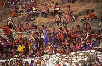 pilgrims sitting at Paro tchetchu with dancer dressing big wood mask, Bhutan