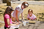 Young children drawing outside