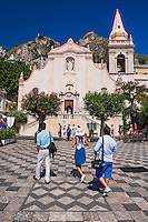 Taormina, tourists at Church of St Joseph in Piazza IX Aprile on Corso Umberto, the main street in Taormina, Sicily, Italy, Europe. This is a photo of tourists at the Church of St Joseph at Piazza IX Aprile on Corso Umberto, the main street in Taormina, Sicily, Italy, Europe.
