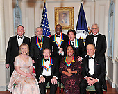 """The 2010 Kennedy Center honorees pose for their formal class photo following the formal Artist's Dinner at the United States Department of State in Washington, D.C. on Saturday, December 4, 2010.  Top row, from left to right: Michael M. Kaiser, President, John F. Kennedy Center for the Performing Arts; Merle Haggard; Bill T. Jones; Sir Paul McCartney; and David M. Rubenstein, Chairman, John F. Kennedy Center for the Performing Arts.  Bottom row, from left to right:  United States Secretary of State Hillary Rodham Clinton; Jerry Herman; Oprah Winfrey; and George Stevens, Jr., creator of """"The Kennedy Center Honors""""..Credit: Ron Sachs / CNP."""