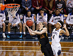 SIOUX FALLS, SD: MARCH 22:  Parker Fox #22 of Northern State shoots past Mike Davis #4 of Queens (NC) during their game at the 2018 Division II Men's Basketball Championship at the Sanford Pentagon in Sioux Falls, S.D. (Photo by Dick Carlson/Inertia)