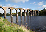 Stone arches of railway viaduct crossing River Tweed, Berwick-upon-Tweed, Northumberland, England, UK