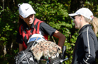 Milton's Mia Seeman (left) talks to coach Andrea Wieland during the WIAA state girls golf championship on Monday, October 12, 2015 at University Ridge Golf Course in Madison, Wisconsin