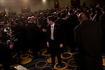 A Secret Service agent keeps watch as President Barack Obama shakes hands at Families USA's 16th Annual Health Action Conference in Washington, D.C., U.S., on Friday, January 28, 2011.