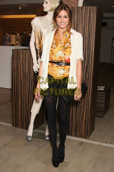 OLIVIA PALERMO.Ports 1961 fashion presentation at Bloomingdale's, New York, NY, USA..November 12th, 2009 .full length black tights shorts sequins sequined white yellow gold top pattern cardigan  clutch bag belt wrap .CAP/LNC/TOM.©TOM/LNC/Capital Pictures