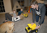 DES MOINES, IOWA- FEB. 17:  Ironman Triathlete TJ Tollakson at home with his family in Des Moines, Iowa (Photo by Donald Miralle/LAVA)