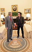 United States President George W. Bush and Bono discuss global AIDS and Africa policy in the Oval Office, Wednesday, October 19, 2005, following lunch in the White House. .Credit: Eric Draper - White House via CNP