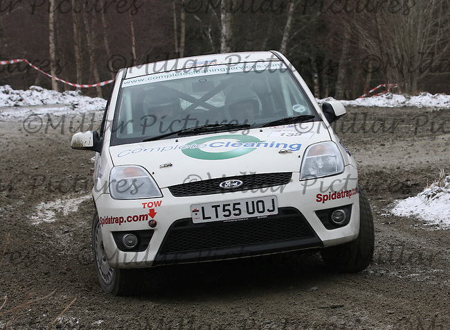 Caroline Carslaw - John D Duke at junction 4 on Special Stage 2 Wauchope on the Brick & Steel Border Counties Rally 2013, Round 2 of the RAC MSA Scottish Rally Championship sponsored by ARR Craib Transport Limited which was organised by Whickham & District and Hawick & Border Car Clubs and based in Jedburgh and held in Kielder Forest on 23.3.13.