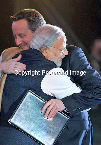 13.11.2015; London, England: BRITISH PM DAVID CAMERON HUGS INDIAN PM NARENDRA MODI<br /> at Modi's London Rally held at Wembley Stadium, London.<br /> Mandatory Credit Photos: &copy;NEWSPIX INTERNATIONAL<br /> <br /> PHOTO CREDIT MANDATORY!!: NEWSPIX INTERNATIONAL(Failure to credit will incur a surcharge of 100% of reproduction fees)<br /> <br /> IMMEDIATE CONFIRMATION OF USAGE REQUIRED:<br /> Newspix International, 31 Chinnery Hill, Bishop's Stortford, ENGLAND CM23 3PS<br /> Tel:+441279 324672  ; Fax: +441279656877<br /> &quot;All fees payable to &quot;Newspix International&quot;<br /> e-mail: info@newspixinternational.co.uk
