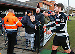 A Darlington fan shakes hands with Simon Ainge as he leaves the pitch. Darlington 1883 v Southport, National League North, 16th February 2019. The reborn Darlington 1883 share a ground with the town's Rugby Union club. <br /> After several years of relegations, bankruptcies, and ground moves, the club is fan owned, and back on an even keel in the National League North.<br /> A 0-0 draw with Southport was marred by a broken leg and dislocated knee suffered by Sam Muggleton, Darlington's on loan left back.<br /> Both teams finished the season in lower mid table.
