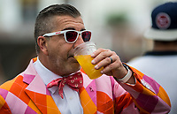 BALTIMORE, MD - MAY 20: A colorfully dressed man wears a breast cancer awareness pin as takes a drink in the infield on Preakness Stakes Day at Pimlico Race Course on May 20, 2017 in Baltimore, Maryland.(Photo by Scott Serio/Eclipse Sportswire/Getty Images)