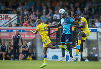 Adebayo Akinfenwa of Wycombe Wanderers beats Deji Oshilaja & Jimmy Abdou (8) of AFC Wimbledon in the air during the Friendly match between Wycombe Wanderers and AFC Wimbledon at Adams Park, High Wycombe, England on 25 July 2017. Photo by Andy Rowland.