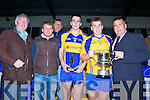 Kenmare  Captain Kieran Fitzgerald  receives the cup from  Patrick O'Sullivan Chairman Kerry County Board after they defeated St Kierans in Fitzgerald Stadium Wednesday night Pius Horgan Acorn Life, Brian Fitzgerald Acorn Life Ger Galvin, Cian Hallissey Man of the Match, Kieran Fitzgerald Captain and Patrick O'Sullivan Chairman Kerry County Board