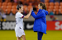 HOUSTON, TX - JANUARY 28: Megan Rapinoe #15 and Andi Sullivan #6 of the United States celebrate after their win past Haiti during a game between Haiti and USWNT at BBVA Stadium on January 28, 2020 in Houston, Texas.