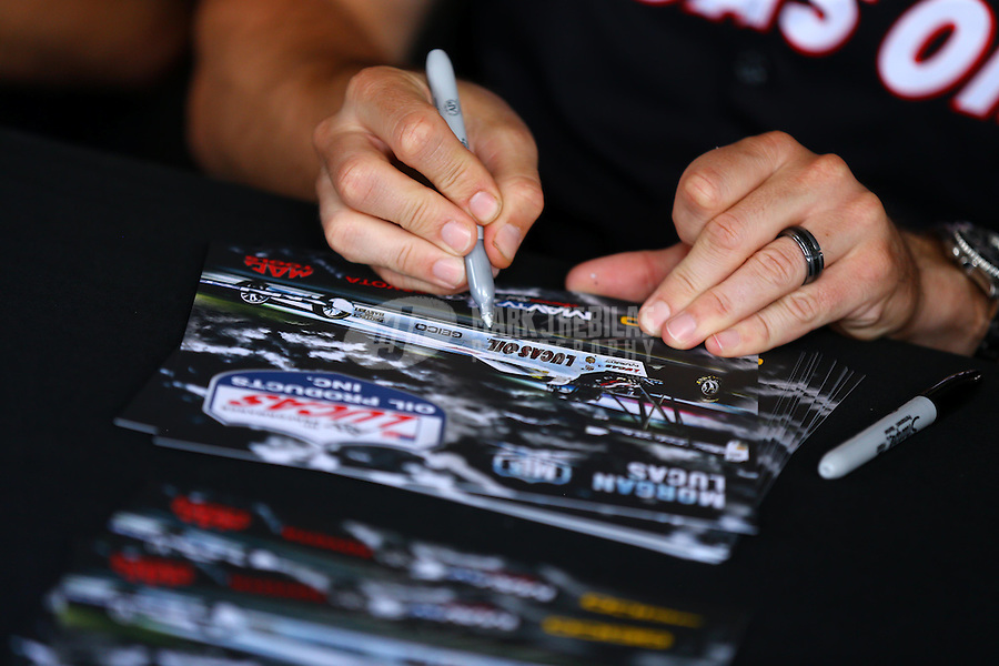 May 30, 2014; Englishtown, NJ, USA; Detailed view as NHRA top fuel driver Morgan Lucas signs a hero card handout during qualifying for the Summernationals at Raceway Park. Mandatory Credit: Mark J. Rebilas-