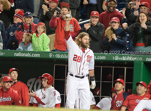 Miami Marlins against the Washington Nationals right fielder Jayson Werth (28) acknowledges the fans after hitting a game-winning grand slam home run in the eighth inning of the game against the Florida Marlins at Nationals Park in Washington, D.C. on Wednesday, April 9, 2014.  The Nationals won the game 10 - 7.<br /> Credit: Ron Sachs / CNP