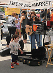 This lad plays with his hat and dances to the music of Deuces Child, Gigi Tanglewood & Lou Patrick, performing at Saugerties Farmer's Market, Saugerties, NY on Saturday, July 2, 2011. Photo © Jim Peppler 2011.