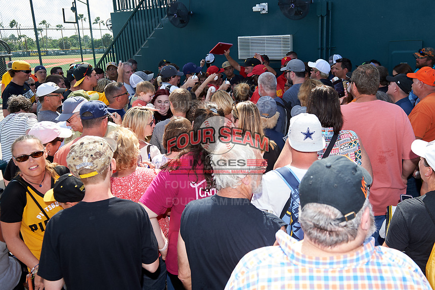 Pittsburgh Pirates Garth Brooks (7) is mobbed as he signs autographs after the teams first Spring Training practice on February 18, 2019 at Pirate City in Bradenton, Florida.  (Mike Janes/Four Seam Images)
