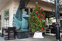Balinese statue and Christmas tree.<br />
