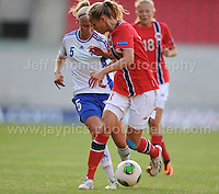 Emma Koivisto of Finland battles with Andrine Tomter of Norway during the UEFA Womens U19 Championships at Parc y Scarlets, Monday 19th August 2013. All images are the copyright of Jeff Thomas Photography-www.jaypics.photoshelter.com-07837 386244-Any use of images must be authorised by the copyright owner.
